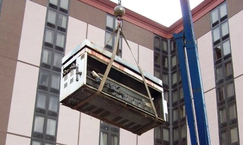 Removing Old Boiler from Multi-Story Hotel Roof
